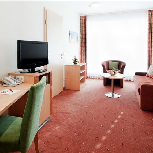 Hotelsuite mit Sitzgelegenheiten