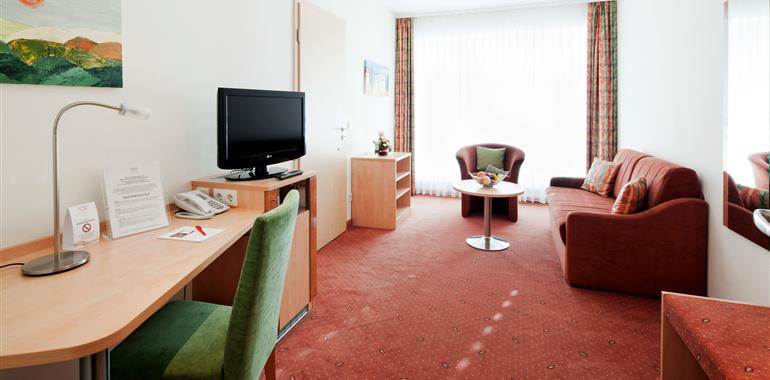 Hotel suite with seating area